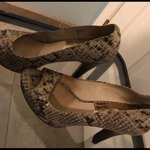Michael Kors snake pattern leather open toe heels.